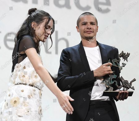 Toby Wallace (L) holds his Marcello Marcello Mastroianni Award for Young Actor for his performance in the movie 'Babyteeth' on stage next to French actress and Venezia 76 jury member Stacy Martin during the awarding ceremony of the 76th annual Venice International Film Festival, in Venice, Italy, 07 September 2019. The festival runs from 28 August to 07 September.