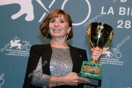 Ariane Ascaride holds the Volpi Cup (Coppa Volpi) award for Best Actress for her performance in the movie 'Gloria Mundi' during the award winners photocall of the 76th annual Venice International Film Festival, in Venice, Italy, 07 September 2019. The festival runs from 28 August to 07 September.
