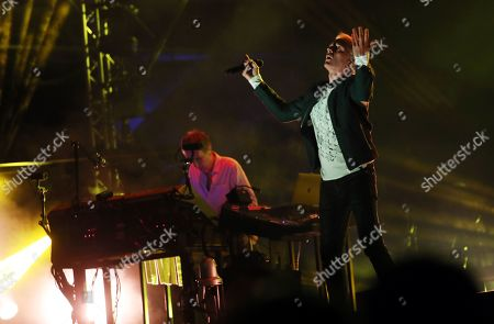 Stock Image of Karl Hyde (R) of British electronic music group Underworld performs at Lollapalooza Berlin 2019 at the Olympiastadion (Olympic stadium) in Berlin, Germany, 07 September 2019. The music festival runs from 07 to 08 September.