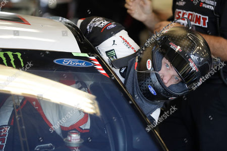 Monster Energy NASCAR Cup Series driver Brad Keselowski climbs into his car during practice for the NASCAR Brickyard 400 auto race at the Indianapolis Motor Speedway, in Indianapolis