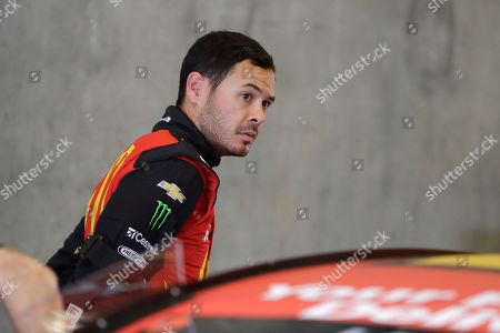 Monster Energy NASCAR Cup Series driver Kyle Larson climbs out of his car during practice for the NASCAR Brickyard 400 auto race at the Indianapolis Motor Speedway, in Indianapolis