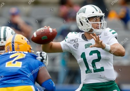 Ohio quarterback Nathan Rourke (12) gets a pass away as Pittsburgh defensive lineman David Green (2) pressures during the first half of an NCAA college football game, in Pittsburgh