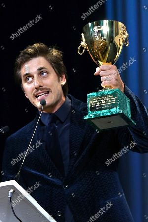 Luca Marinelli holds the Coppa Volpi for Best Actor for his role in the film 'Martin Eden' at the closing ceremony of the 76th edition of the Venice Film Festival, Venice, Italy