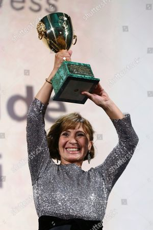 Ariane Ascaride holds aloft the Coppa Volpi for Best Actress for her role in the film 'Gloria Mundi' at the closing ceremony of the 76th edition of the Venice Film Festival, Venice, Italy