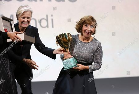 Ariane Ascaride receives the Coppa Volpi for Best Actress for her role in the film 'Gloria Mundi' at the closing ceremony of the 76th edition of the Venice Film Festival, Venice, Italy