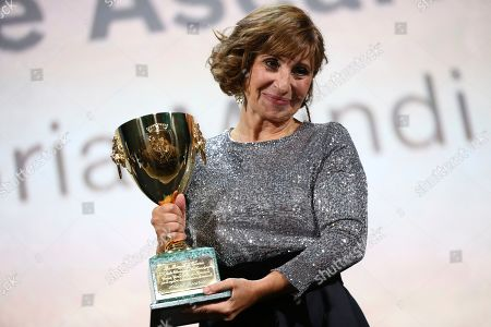 Ariane Ascaride holds the Coppa Volpi for Best Actress for her role in the film 'Gloria Mundi' at the closing ceremony of the 76th edition of the Venice Film Festival, Venice, Italy