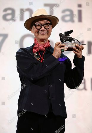 Yonfan, holds the award for Best Screenplay for the film 'No. 7 Cherry Lane at the closing ceremony of the 76th edition of the Venice Film Festival, Venice, Italy
