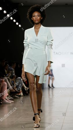 Stock Photo of A model presents a creation by Chinese designer Taoray Wang during New York Fashion Week in New York, New York, USA, 07 September February 2019. New York Fashion Week for designer's Spring and Summer lines are being held from 05 to 11 September 2019.