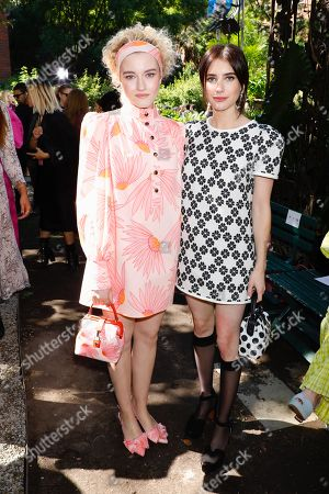Julia Garner and Emma Roberts in the front row