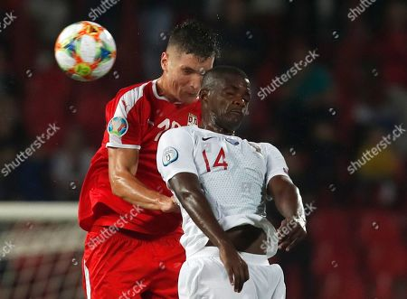 Serbia's Nikola Milenkovic, left, fights for the ball with Portugal's William Carvalho, right, during the Euro 2020 group B qualifying soccer match between Serbia and Portugal, on the stadium Rajko Mitic in Belgrade, Serbia
