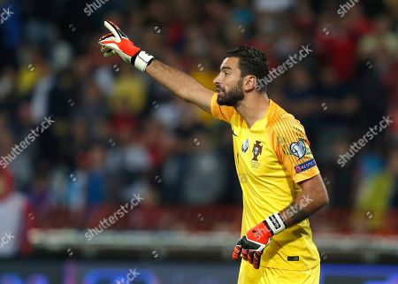 Portugal goalkeeper Rui Patricio gestures during the Euro 2020 group B qualifying soccer match between Serbia and Portugal, on the stadium Rajko Mitic in Belgrade, Serbia