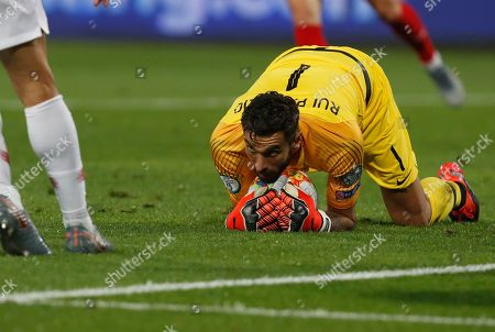 Portugal goalkeeper Rui Patricio makes a save during the Euro 2020 group B qualifying soccer match between Serbia and Portugal, on the stadium Rajko Mitic in Belgrade, Serbia