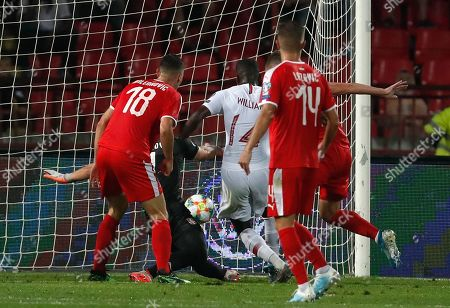 Portugal's William Carvalho, centre, scores his side's opening goal during the Euro 2020 group B qualifying soccer match between Serbia and Portugal, on the stadium Rajko Mitic in Belgrade, Serbia