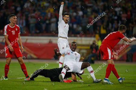 Portugal's William Carvalho, front center, and Portugal's Cristiano Ronaldo, center back, jubilate after Carvalho had scored a goal as Serbia's Nikola Milenkovic, left, and Serbia's Uros Spajic react during their Euro 2020 group B qualifying soccer match at the Rajko Mitic stadium in Belgrade, Serbia