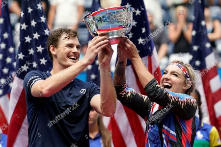 Jamie Murray, of the United Kingdom, left, and Bethanie Mattek-Sands, of the United States, hold up the championship trophy after winning the mixed doubles final against Chan Hao-ching, of Taiwan, and Michael Venus, of New Zealand, at the U.S. Open tennis championships, in New York