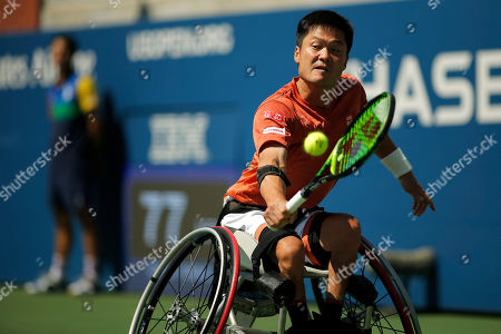 Shinjo Kunieda, of Japan, returns a shot to Alfie Hewett, of the United Kingdom, during the men's wheelchair singles quarterfinals of the U.S. Open tennis championships, in New York