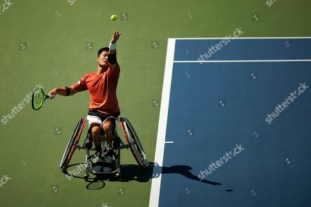 Shinjo Kunieda, of Japan, serves to Alfie Hewett, of the United Kingdom, during the men's wheelchair singles quarterfinals of the U.S. Open tennis championships, in New York