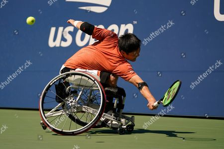 Stock Picture of Shinjo Kunieda, of Japan, returns a shot to Alfie Hewett, of the United Kingdom, during the men's wheelchair singles quarterfinals of the U.S. Open tennis championships, in New York