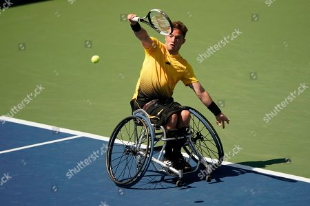 Stock Image of Alfie Hewett, of the United Kingdom, returns a shot to Shinjo Kunieda, of Japan, during the men's wheelchair singles quarterfinals of the U.S. Open tennis championships, in New York