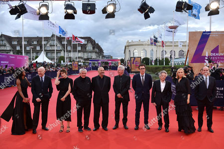 Stock Image of French journalist Audrey Pulvar, French director Jean Paul Rappeneau, French director Valerie Donzelli, French director Claude Lelouch, French director Jean Pierre Jeunet, French director Regis Wargnier, French director Michel Hazanavicius, Polish-French director Roman Polanski, French actress Emmanuelle Beart and French journalist Pierre Lescure arrive on the red carpet prior to the premiere 'Music of My Life (Blinded by the Light)' during the 45th Deauville American Film Festival, in Deauville, France, 07 September 2019. The festival runs from 06 to 15 September.