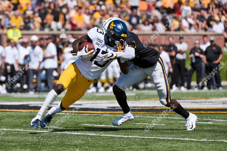 West Virginia Mountaineers wide receiver Sam James (13) tries to get away from the tackle attempt of Missouri Tigers defensive back DeMarkus Acy (2) during a non conference game where the West Virginia Mountaineers visited the Missouri Tigers held at Faurot Field at Memorial Stadium in Columbia, MO Richard Ulreich/CSM