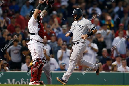 Gary Sanchez, Christian Vazquez. New York Yankees' Gary Sanchez, right, scores in front of Boston Red Sox's Christian Vazquez on a double by Edwin Encarnacion during the ninth inning of a baseball game in Boston