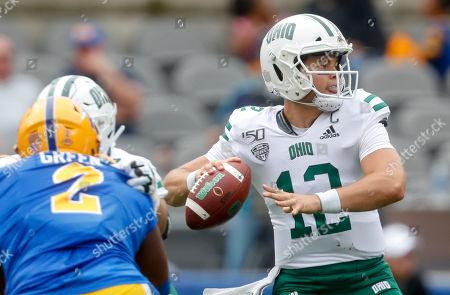 Ohio quarterback Nathan Rourke (12) looks to pass as he is pressured y Pittsburgh defensive lineman David Green (2) during the first half of an NCAA college football game, in Pittsburgh