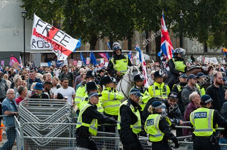 Police officers cordon off Parliament Square as pro-Brexit supporters of Tommy Robinson and Boris Johnson demonstrate in support of Brexit.