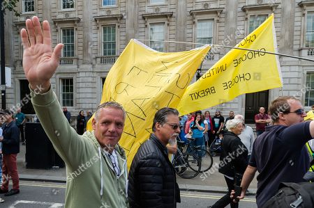 Pro-Brexit supporters of Tommy Robinson and Boris Johnson march down Whitehall as hundreds of pro-EU demonstrators take part in 'Stop the Coup' protests against the prorogation of the UK Parliament.