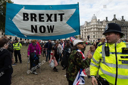 Stock Picture of Pro-Brexit supporters of Tommy Robinson and Boris Johnson stage a counter demonstration in Parliament Square as hundreds of pro-EU demonstrators take part in 'Stop the Coup' protests against the prorogation of the UK Parliament.