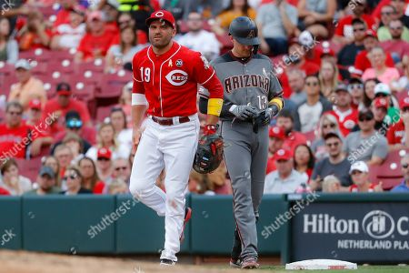 Joey Votto, Nick Ahmed. Cincinnati Reds first baseman Joey Votto (19) reacts after stumbling on a play at first as Arizona Diamondbacks' Nick Ahmed reaches on a single off starting pitcher Luis Castillo inning of a baseball game, in Cincinnati