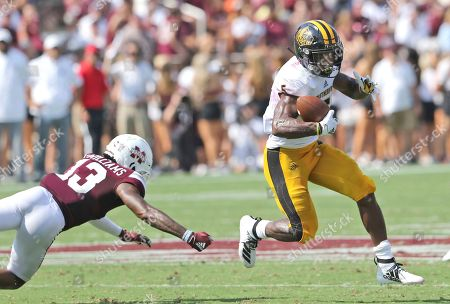 Stock Picture of Southern Mississippi wide receiver Tim Jones (5) scrambles away from Mississippi State cornerback Tyler Williams (13) in the first half of an NCAA college football game, in Starkville, Miss