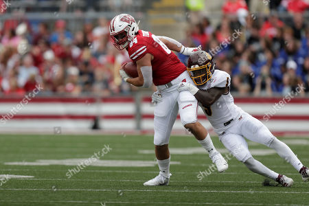 Wisconsin tight end Jake Ferguson (84) and Central Michigan defensive back Devonni Reed (5) during the first half of an NCAA college football game, in Madison, Wis