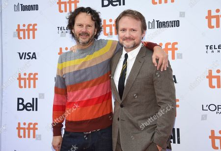 "Ram Bergman, Rian Johnson. Producer Ram Bergman, left, and writer/director/producer Rian Johnson attend the premiere for ""Knives Out"" on day three of the Toronto International Film Festival at the Princess of Wales Theatre, in Toronto"