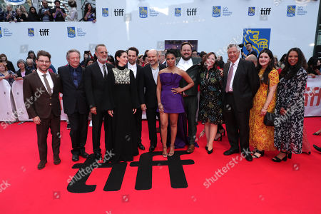Stock Image of Micah Fitzerman-Blue, Executive Producer, Chris Cooper, Tom Hanks, Marielle Heller, Director, Matthew Rhys, Enrico Colantoni, Susan Kelechi Watson, Noah Harpster, Executive Producer, Hannah Minghella, President of TriStar Pictures, Tony Vinciquerra, Chairman and CEO of Sony Pictures Entertainment, Nicole Brown, SVP Film TriStar Pictures, Shary Shirazi