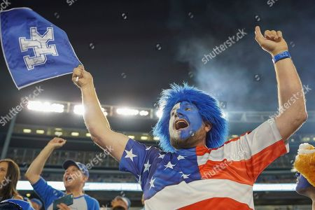Kentucky fan Josh Henry, of Louisville, Ky, celebrates after a play during the second half of an NCAA college football game between Kentucky and Eastern Michigan, in Lexington, Ky
