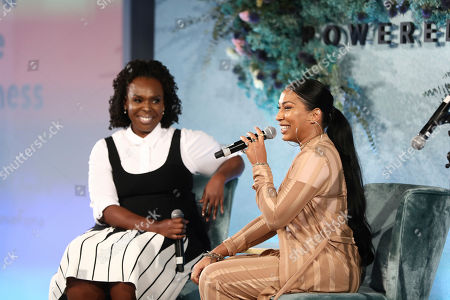 Melanie Fiona, right, and Cece Olisa speak on a panel at the 5th annual theCURVYcon powered by Dia&Co on in New York