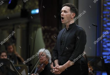 Stock Image of British classical countertenor Iestyn Davies, as Orfeo, performs with the 'Orchestra of the Age of Enlightenment' (OAE) in the Gluck's opera 'Orfeo ed Euridice' on the stage of the Romanian Athenaeum concert hall during the George Enescu International Festival 2019, in Bucharest, Romania, 07 September 2019. The festival, held every two years since 1958, is the biggest classical music festival held in Romania, in honor of Romanian composer and violinist George Enescu. The 24th edition of the George Enescu International Festival takes place between 31 August and 22 September 2019.