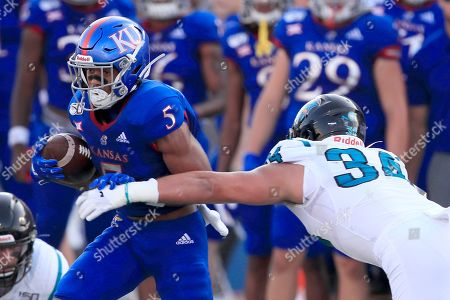 Stephon Robinson Jr., Teddy Gallagher. Kansas wide receiver Stephon Robinson Jr. (5) breaks away from Coastal Carolina linebacker Teddy Gallagher (34) during the first half of an NCAA college football game in Lawrence, Kan
