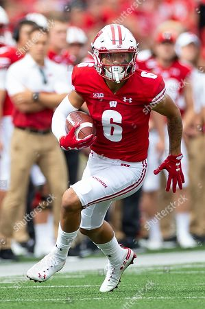 Wisconsin Badgers wide receiver Danny Davis III #6 runs after the catch during the NCAA Football game between the Central Michigan Chippewas and the Wisconsin Badgers at Camp Randall Stadium in Madison, WI
