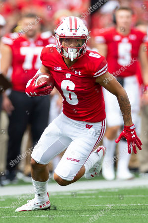 Stock Photo of Wisconsin Badgers wide receiver Danny Davis III #6 runs after the catch during the NCAA Football game between the Central Michigan Chippewas and the Wisconsin Badgers at Camp Randall Stadium in Madison, WI