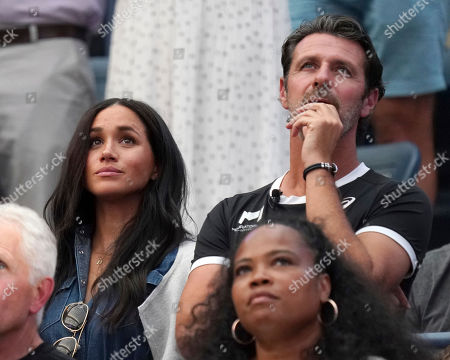 Meghan Duchess of Sussex, left, and Patrick Mouratoglou attend the women's finals of the U.S. Open tennis championships, in New York