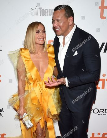 """Stock Image of Jennifer Lopez, Alex Rodriguez. Jennifer Lopez, left, and Alex Rodriguez attend the premiere for """"Hustlers"""" on day three of the Toronto International Film Festival at Roy Thomson Hall, in Toronto"""