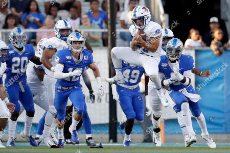 Tennessee State kick holder Chris Rowland (3) catches the ball after Middle Tennessee players blocked an extra point attempt in the first half of an NCAA college football game, in Murfreesboro, Tenn