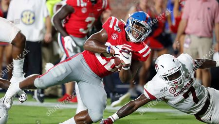 Scottie Phillips, Joe Foucha. Mississippi running back Scottie Phillips (22) dives next to Arkansas defensive back Joe Foucha (7) during the second half of their NCAA college football game, in Oxford, Miss