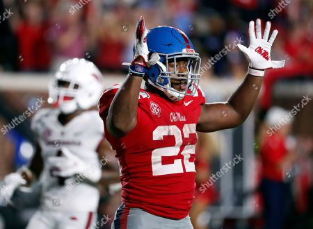Mississippi running back Scottie Phillips (22) celebrates his touchdown run against Arkansas during the second half of an NCAA college football game, in Oxford, Miss. Mississippi won 31-17