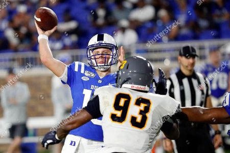 Chris Katrenick, Jermaine McDaniel. Duke's Chris Katrenick (15) tries to pass the ball over North Carolina A&T's Jermaine McDaniel (93) during the second half of an NCAA college football game in Durham, N.C