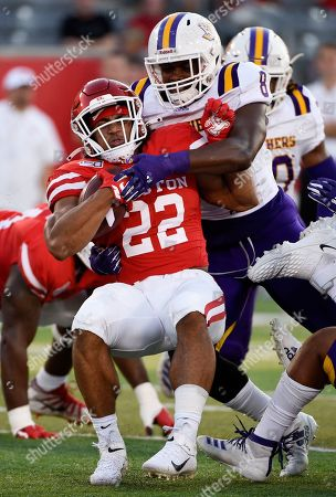 Houston running back Kyle Porter (22) is tackled by Prairie View defensive end Isaiah Washington during the first half of an NCAA college football game, in Houston