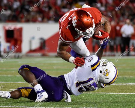 Stock Image of Houston running back Kyle Porter, top, is tackled by Prairie View defensive back Darius Campbell during the first half of an NCAA college football game, in Houston