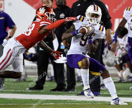 Prairie View wide receiver Chris Johnson, right, catches a pass as Houston cornerback Torey Richardson defends during the second half of an NCAA college football game, in Houston
